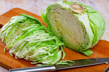Fresh Green Cabbage Sliced On ...