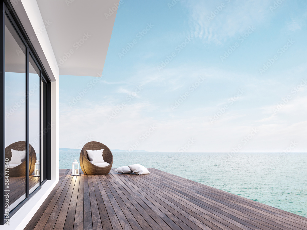 Fototapeta Minimal style room terrace with sea view 3d render,There has dark wooden floors,decorated with rattan furniture and white lantern ,overlooking the sea and sky.