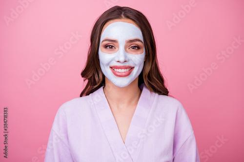 Obraz na plátně Photo portrait of happy smiling young woman wearing bathrobe pampering skin appl