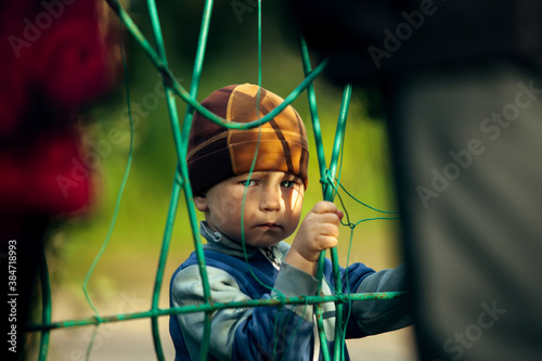 Canvas Print An aggrieved little boy, with a sad look in his eyes.