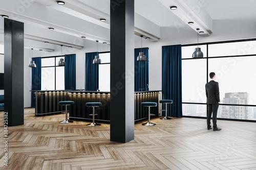 Fototapeta Businessman standing in luxury office hall with bar counter obraz na płótnie