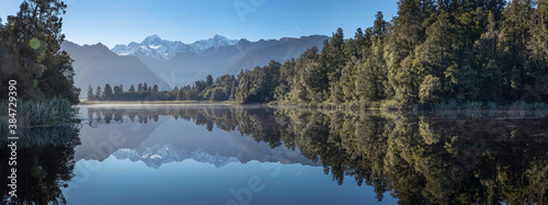 Lake Matheson New Zealand South Island. Panorama. Reflection of Fox Glacier. Snow capped moutains. South Island. Westcoast.