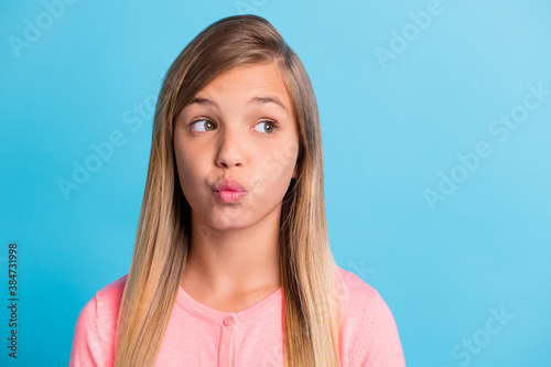 Платно Photo portrait of pouting girl looking at blank space isolated on pastel blue co
