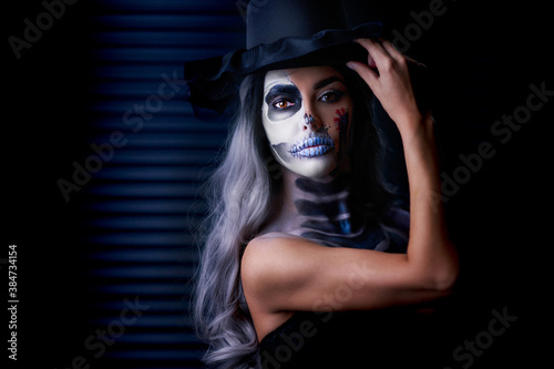 Spooky portrait of woman in halloween gotic makeup