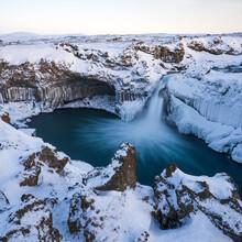 Aldeyjarfoss Waterfall At Sunset In Winter. Columnar Basalt Formations Around The Fall. North Iceland.