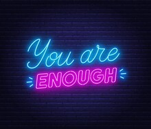 You Are Enough Neon Quote On A Brick Wall. Inspirational Glowing Lettering.