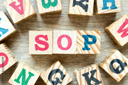 Obraz na plátně Alphabet letter block in word SOP (Abbreviation of standard operating procedure)