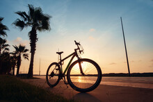 A Silhouette Of A Bike At Suns...