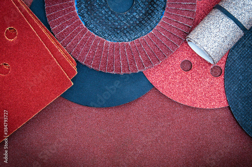 A set of abrasive tools and brown sandpaper for cleaning or sanding various obje Wallpaper Mural