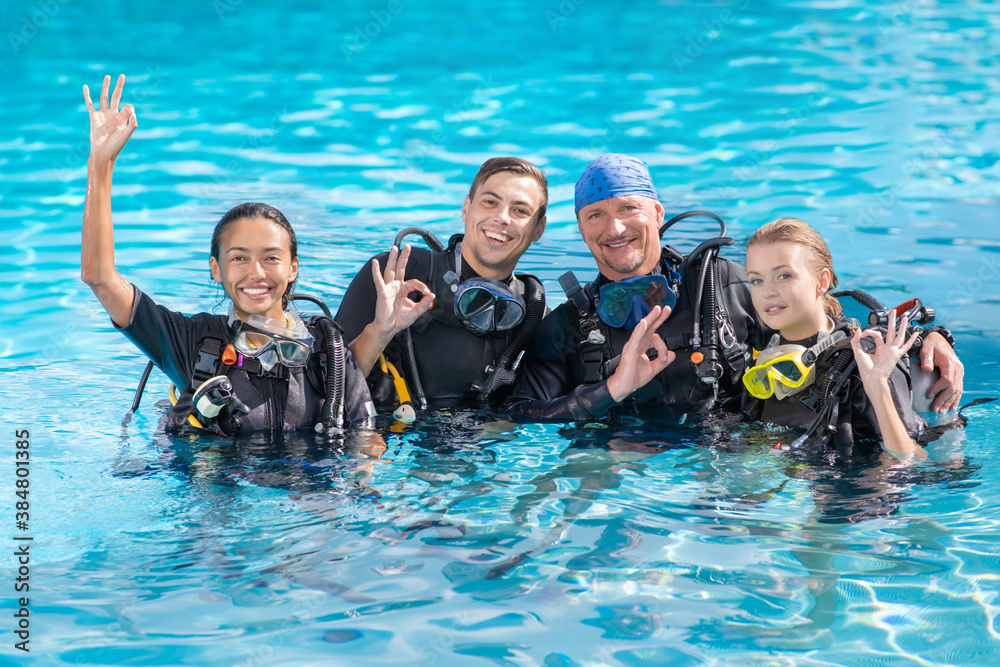 Fototapeta A group of people practice scuba diving in the pool. Diving as an extreme sport