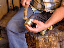 Traditional Workshop Of A Master Coppersmith Making A Hand-made Artisan  Carved Brass Metal Shots