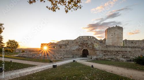 sunbeams in the window of the medieval castle of Zamora, Spain.