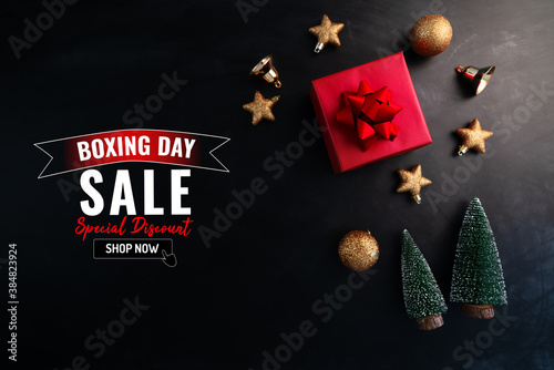 Boxing day sale with Christmas present and xmas decoration on bl