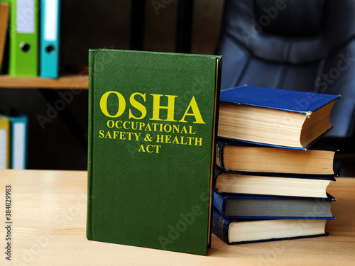 Occupational Safety and Health Act OSHA book and stack of documents Wallpaper Mural
