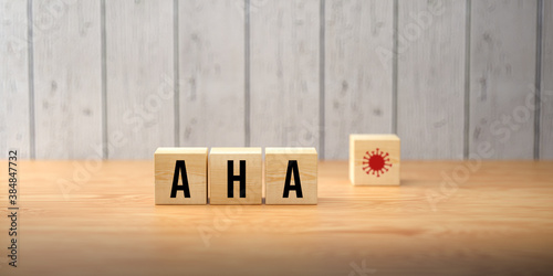 Obraz German acronym AHA for the three rules in a pandemic DISTANCE, HYGIENE, FACE MASKS on wooden background - fototapety do salonu