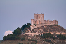 Full Moonrise Over An Ancient Castle In Spain.