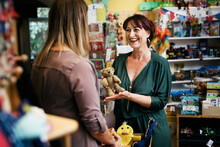 Customer Talking To Shop Owner About Selling Some Toys