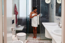Woman Wrapping Herself With A Towel