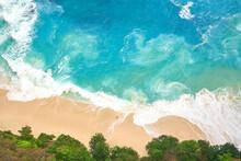 Blue Sea Waving On Sandy Beach