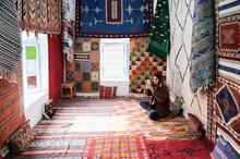 Tourist In Carpet Shop Take Ph...