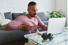 Man Shopping Online At Home