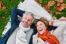 Laughing Mature Couple Lying On Grass