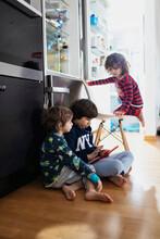 Kids Looking A Digital Tablet
