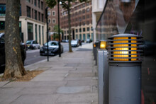 Grey Street Bollard And Lighting With Blurred Background Street Scene.