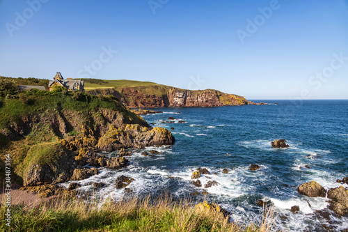 Tablou Canvas A view of  waves crashing on cliffs at Saint Abbs, Scotland, UK