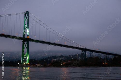 A view of the Lion's Gate Bridge connecting Vancouver to the North Shore through Stanley Park, over English Bay in British Columbia, at night Wallpaper Mural