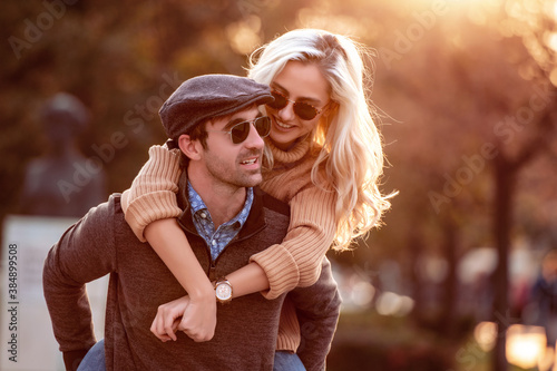 Smiling couple in love outdoors Wallpaper Mural