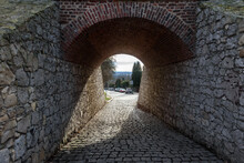 Arched Stone Passage Under Bri...