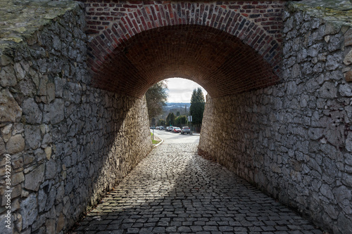 Fotomural Arched stone passage under bridge on city street in Krakow, Poland