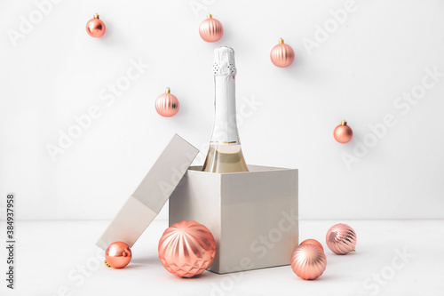Obraz New Year composition with bottle of champagne on light background - fototapety do salonu