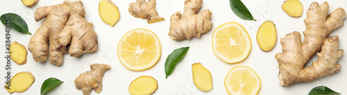 Obraz na plátně Fresh ginger and lemon on white background, top view