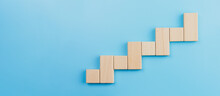 Wooden Block Stacking As Step Stair Blue Background, Ladder Of Success In Business Growth Concept, Copy Space