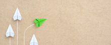 Group Of White Paper Plane In One Direction And One Green Paper Plane Pointing In Different Way. Business For Innovative Solution Concept, Copy Space