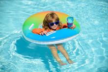 Happy Kid Playing With Swim Fl...