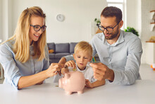 Curious Little Kid Saving Up Money And Learning About Financial Literacy From Young Parents