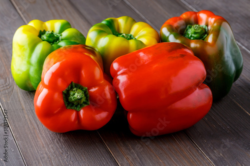 Fresh red, orange, green and yellow sweet bell paprika close up Fototapete