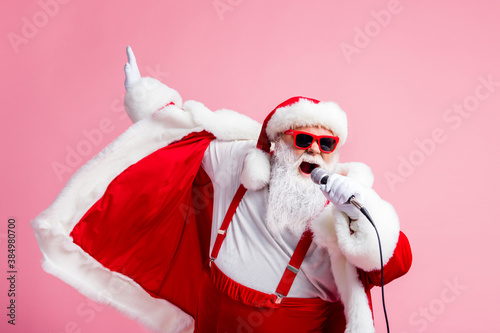 2021 coming sing song mic funky grey beard santa claus pop star have x-mas christmas live concert wear suspenders sunglass headwear cap isolated over pastel color background