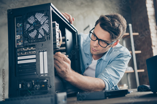 Obraz Close-up portrait of his he nice attractive focused professional guy skilled technician repairing hardware detail fan cooler support at modern loft industrial home office work workplace workstation - fototapety do salonu