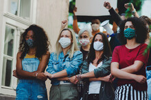 Group Of People Activists Protesting On Streets, Women March, Demonstration And Coronavirus Concept.