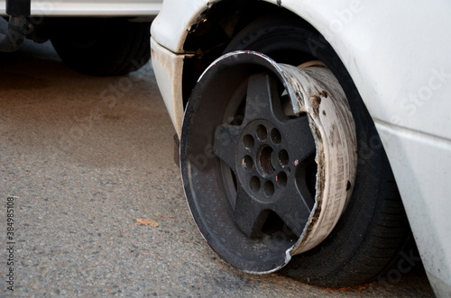 puncture and retraction of the car tire on the curb at high speed will damage the aluminum wheel rim and retract the rubber Canvas Print