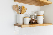 Kitchen Shelves With Various White Ceramic And Glass Jars.