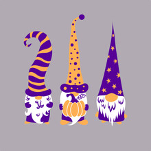 Three Cute Scandinavian Halloween Gnomes Holding Pumpkin Isolated On Grey Background.