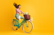 canvas print picture Full length body size photo of funny girl shouting riding bicycle keeping legs up isolated on vivid yellow color background
