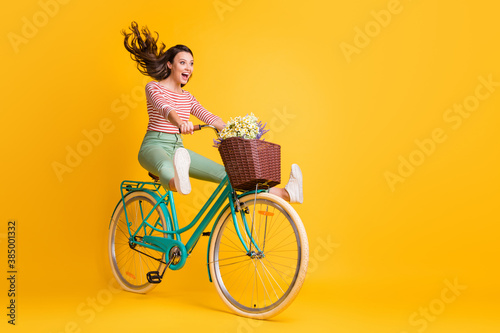 Fotografija Full length body size photo of funny girl shouting riding bicycle keeping legs u