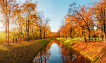 Beautiful Sunny Autumn Day. Panorama Of The Autumn Park With Walking People. Tsarskoe Selo. Russia.