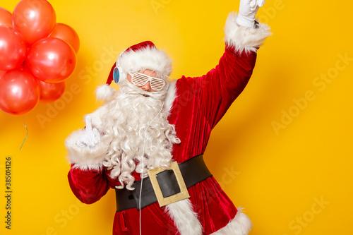 Fototapeta Santa Claus listening to the music and dancing obraz